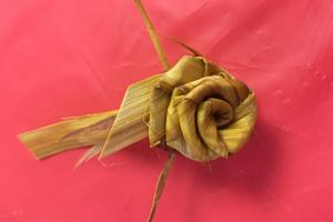 a rose flower made from cedar wood shavings
